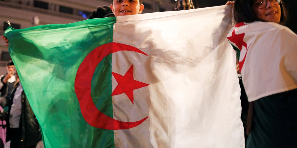Youth celebrate on the streets after President Abdelaziz Bouteflika announced he will not run for a fifth term, in Algiers, Algeria March 11, 2019. REUTERS/Zohra Bensemra