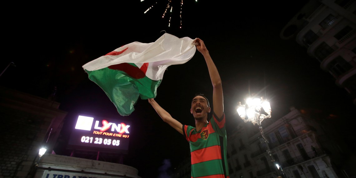 A man celebrates on the streets after President Abdelaziz Bouteflika announced he will not run for a fifth term, in Algiers, Algeria March 11, 2019. REUTERS/Ramzi Boudina
