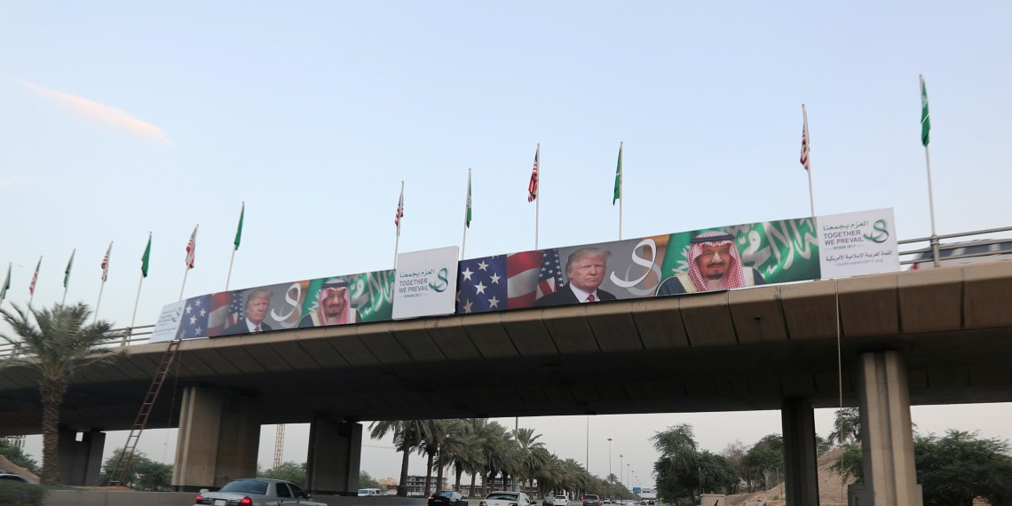 FILE PHOTO: U.S. President Donald Trump's and Saudi Arabia's King Salman bin Abdulaziz Al Saud's photos are seen with flags of both countries on Mecca Road as part of celebrations to welcome United States President Donald Trump, in Riyadh, Saudi Arabia, May 19, 2017. REUTERS/Hamad I Mohammed