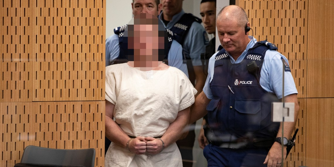 Brenton Tarrant, charged for murder in relation to the mosque attacks, is lead into the dock for his appearance in the Christchurch District Court, New Zealand March 16, 2019. Mark Mitchell/New Zealand Herald/Pool via REUTERS.