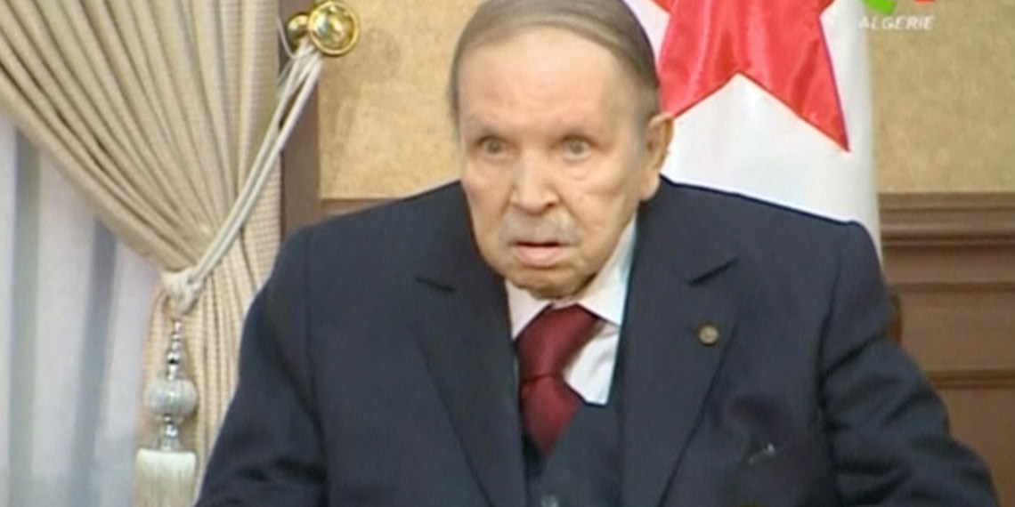 FILE PHOTO: Algeria's President Abdelaziz Bouteflika looks on during a meeting with army Chief of Staff Lieutenant General Gaid Salah in Algiers, Algeria, in this handout still image taken from a TV footage released on March 11, 2019. Algerian TV /Handout via Reuters