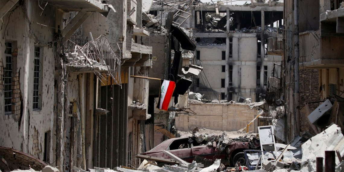 FILE PHOTO: An Iraqi flag is seen amid destroyed buildings during fighting between Iraqi forces and Islamic State militants in the Old City of Mosul, Iraq, July 4, 2017. REUTERS/Ahmed Saad/File Photo