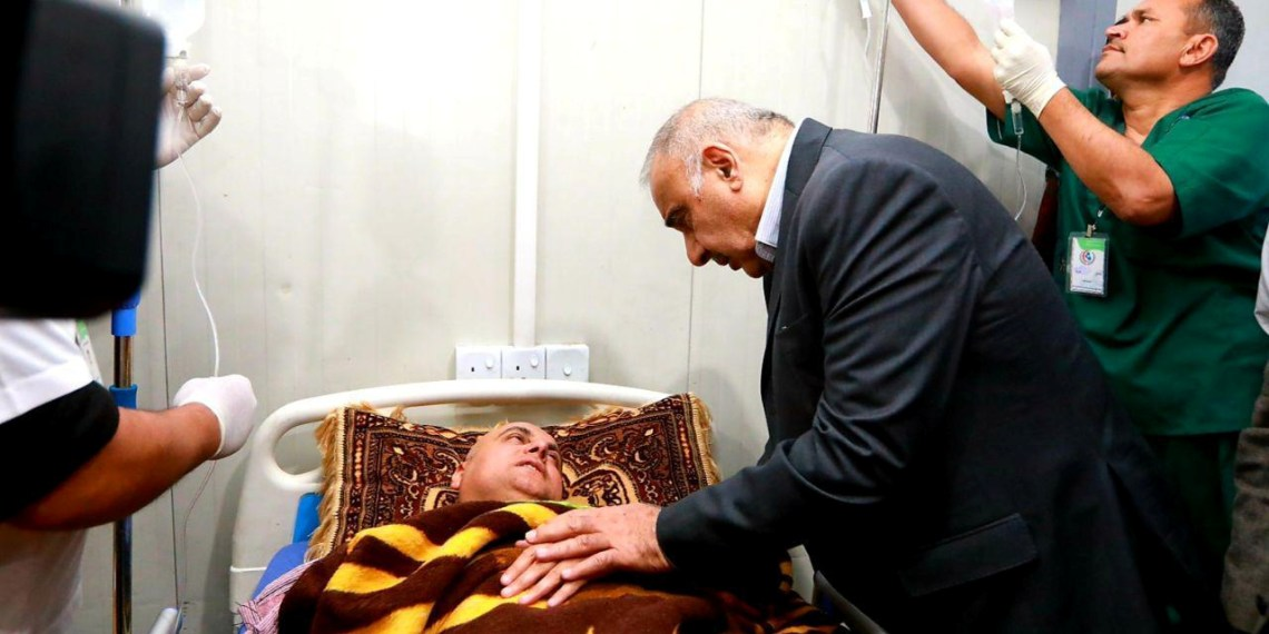 Iraq's Prime Minister Adel Abdul Mahdi visits the people injured after a ferry sank in the Tigris river, at Salam hospital in Mosul, Iraq March 21, 2019. Picture taken March 21, 2019. Iraqi Prime Minister Media Office/Handout via REUTERS