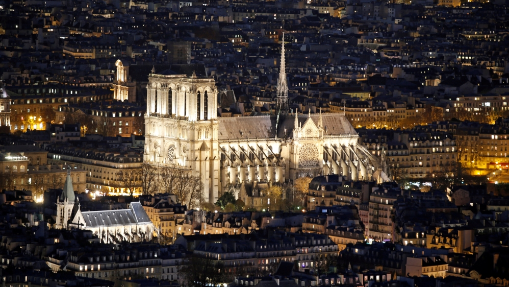 The cathedral, which is famous for featuring in Victor Hugo's classic novel The Hunchback of Notre Dame, attracts millions of tourists every year [File: Charles Platiau/Reuters]