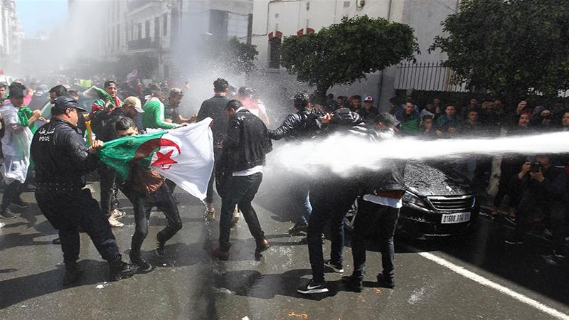 Algerian security forces use a water cannon to disperse students protesting in Algeria [AFP]
