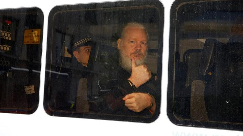 A bearded and frail-looking Julian Assange being arrested by British police in London on April 11, 2019. (Reuters)