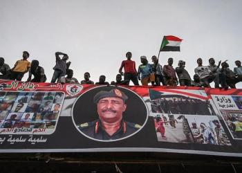 Sudanese protestors shout slogans as they wave Sudan national flags during a protest outside the army complex in the capital Khartoum on April 20, 2019. (AFP)