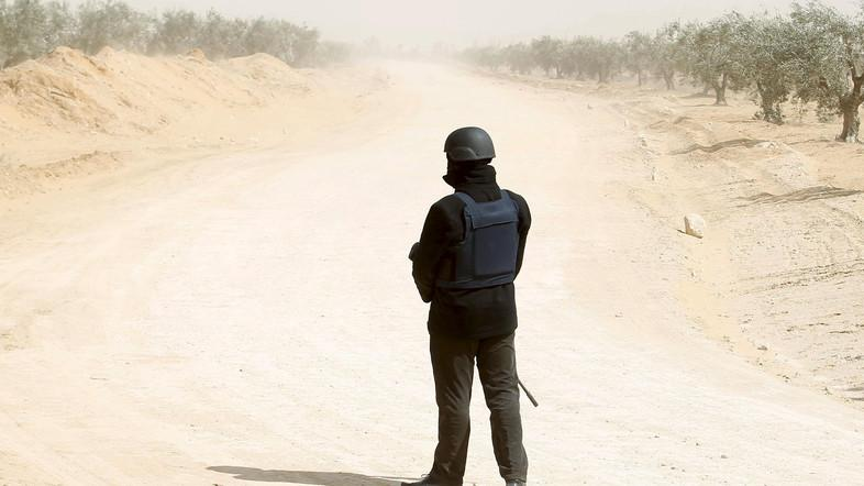 A file photo of a Tunisian police officer stands guard during an operation in the town of Ben Guerdane, near the Libyan border. (Reuters)