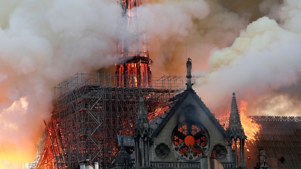 The iconic structure in central Paris in flames [Benoit Tessier/Reuters]