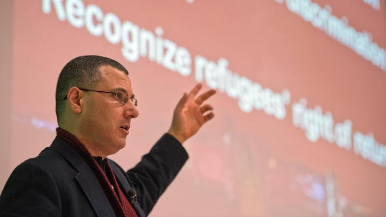 Omar Barghouti speaks during a conference at the ULB University in Brussels on April 30, 2013. (AFP)