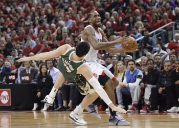 Toronto Raptors forward Kawhi Leonard drives into Milwaukee Bucks forward Ersan Ilyasova during the second half of Game 3 of the NBA basketball playoffs Eastern Conference finals in Toronto on May 19, 2019. (Nathan Denette/The Canadian Press via AP)