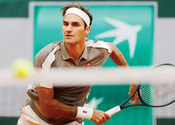 Switzerland's Roger Federer in action during his first round match against Italy's Lorenzo Sonego on Sunday. (Reuters)