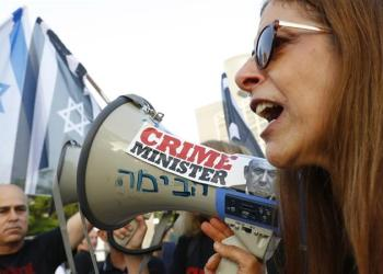 Israeli oposition parties' supporters attend a rally against Prime Minister Benjamin Netanyahu [Jack Guez/AFP]