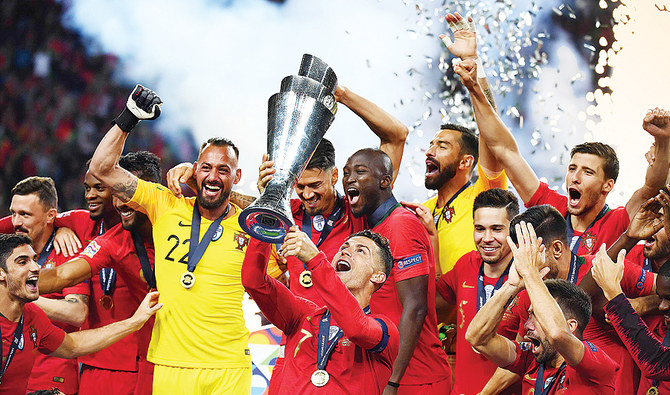 Portugal's forward Cristiano Ronaldo celebrates with teammates after the UEFA Nations League final football match against the Netherlands. (AFP)
