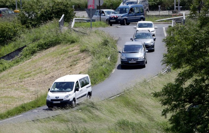 A vehicle, left, allegedly transporting orphaned children of French militants leaves the Velizy-Villacoublay airport on Monday, June 10, 2019. (AFP)