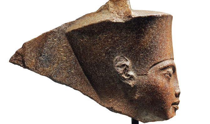 A handout picture released by Christies auction house in London on June 11, 2019 shows an ancient sculpture representing King Tutankhamun's head. The Egyptian embassy in London requested that Britain prevent the planned sale by Christie's of an ancient sculpture representing King Tutankhamun's head and return it to Egypt, Cairo said. (AFP)