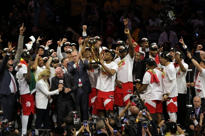 Toronto Raptors forward Kawhi Leonard lifts the Larry O'Brien Championship Trophy after beatiing Golden State Warriors for the NBA Championship. (USA TODAY Sports/Reuters)