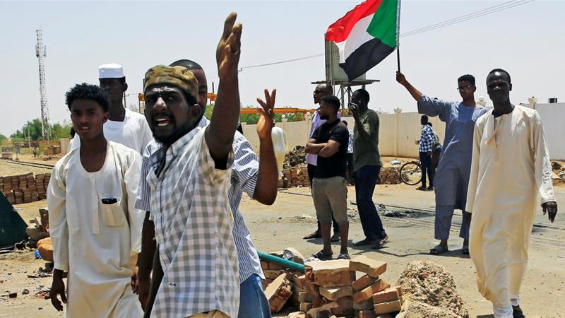 Sudanese protesters set up a barricade on a street in Khartoum, demanding that the country's Transitional Military Council hand over power to civilians [Reuters]