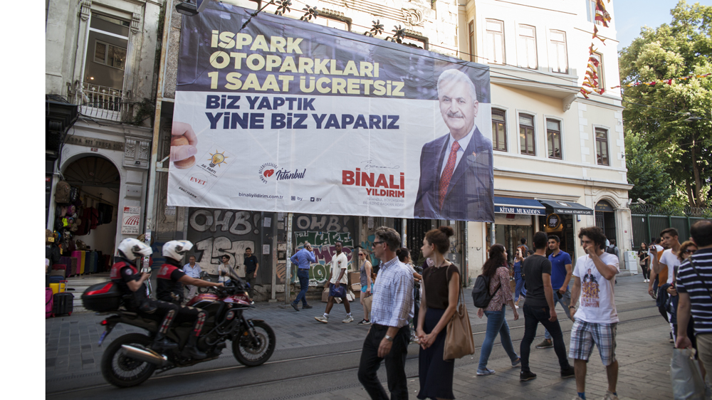 An AK Party poster says it will give the first hour free in car parks, an example of the list of offers and 'freebies' both candidates are making to the people of Istanbul [Tessa Fox/Al Jazeera]