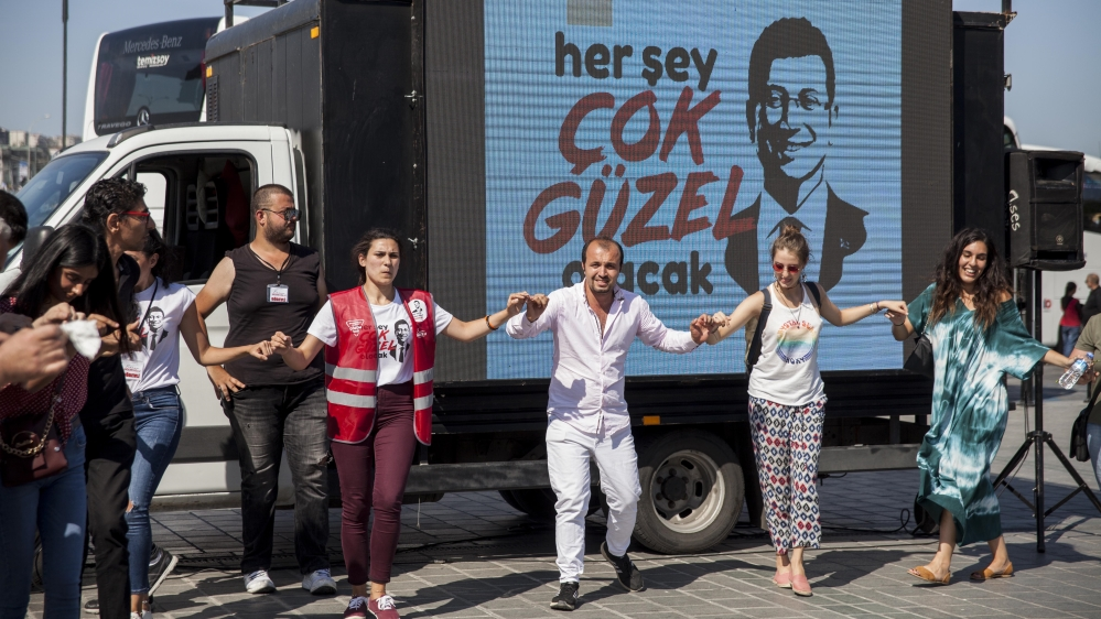 Imamoglu's new slogan, which translates to 'everything will be very beautiful,' has been plastered across Istanbul in the weeks leading up to the vote [Tessa Fox/ Al Jazeera]