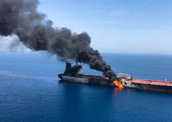 The crude oil tanker Front Altair on fire in the Gulf of Oman after Thursday's attack [File: EPA]