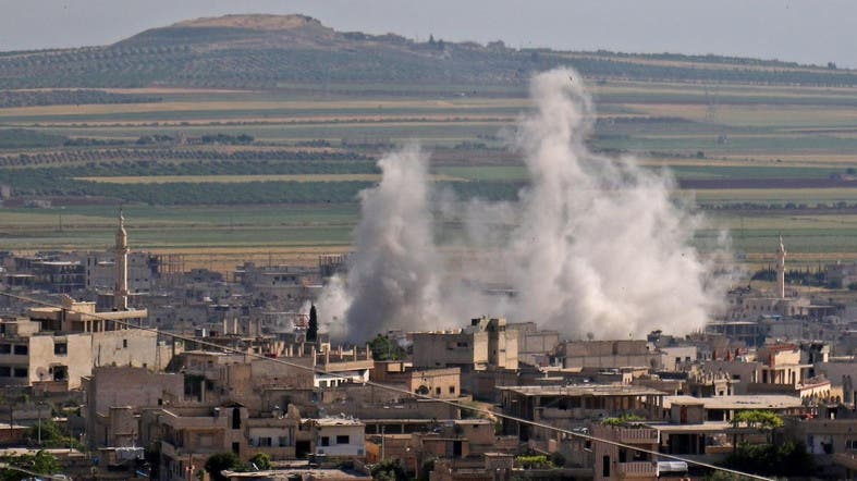 Smoke billows following regime bombardment on the town of Khan Shaykhun in Idlib on May 14, 2019. (File photo: AFP)