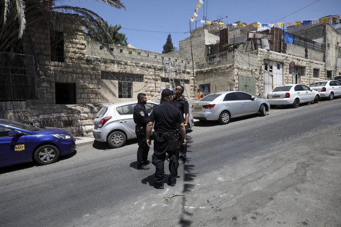 Israeli police stand in front of a house after a Palestinian family was evicted in east Jerusalem's neighborhood of Silwan, Wednesday, July 10, 2019. Officers removed the Siyyam family from the premises on Wednesday after an Israeli court ruled in favor of Elad, an Israeli group working to strengthen Jewish presence in east Jerusalem. (AP)