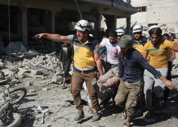 Civilians and civil defence members carry out search and rescue works at the site after Russian war planes carried out air raids on a marketplace in Maarat al-Numan district [Anadolu]