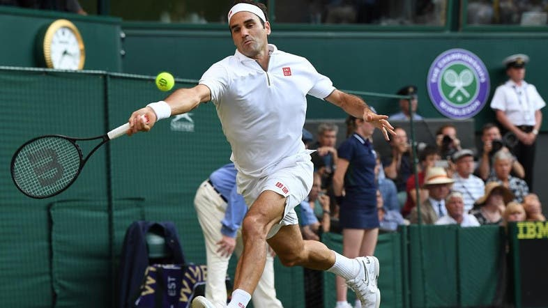Roger Federer returns against Rafael Nadal during their men's singles semi-final match on day 11 of the 2019 Wimbledon Championships on July 12, 2019. (AFP)