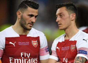 Sead Kolasinac and Mesut Ozil were uninjured in the attempted carjacking