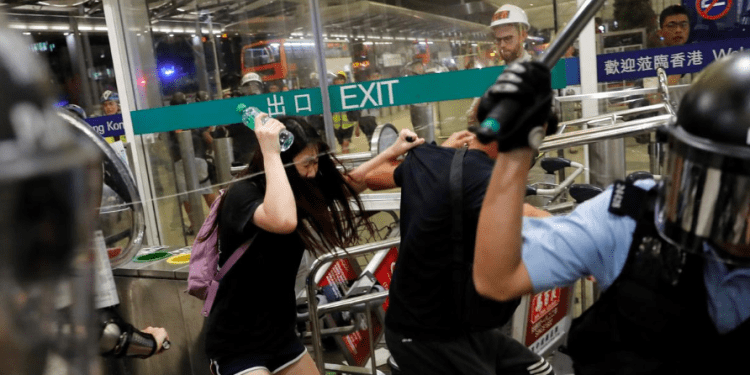 Police clash with anti-government protesters at the airport in Hong Kong, China August 13, 2019. REUTERS/Thomas Peter
