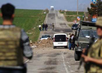 Turkish soldiers secure the scene of an explosion on the road linking the cities of Diyarbakir and Bingol, in southeastern Turkey. (File photo: AP)