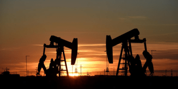 FILE PHOTO: Pump jacks operate at sunset in an oil field in Midland, Texas U.S. August 22, 2018. REUTERS/Nick Oxford/File Photo