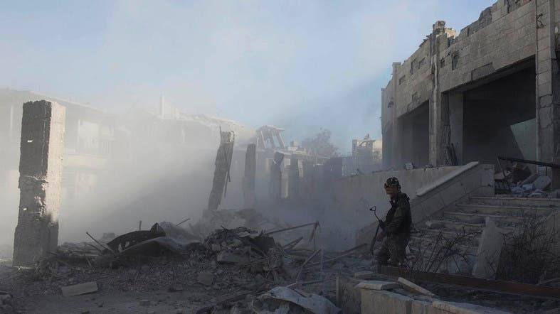 First responders pulled nearly 20 bodies out of the latest mass grave uncovered in Raqqa, Syria. (File photo: AP)