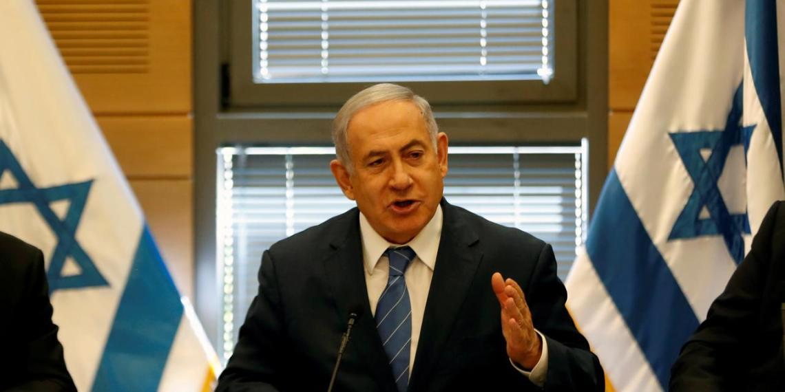 FILE PHOTO: Israeli Prime Minister Benjamin Netanyahu delivers a statement to the media at the start of his Likud party faction meeting at the Knesset, Israel's parliament, in Jerusalem, September 23, 2019. REUTERS/Ronen Zvulun/File Photo