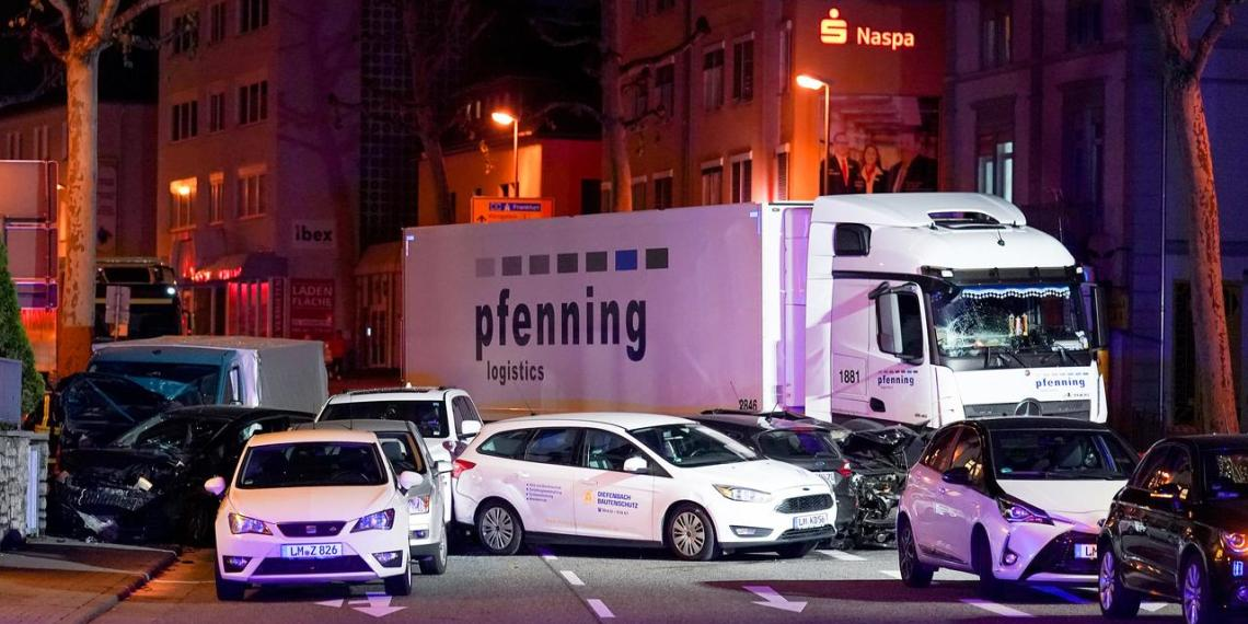 A truck stands beside damaged cars in Limburg, Germany, October 7, 2019, after several people were injured when a stolen truck drove into vehicles during rush hour. REUTERS/Stringer