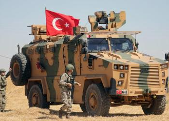 FILE PHOTO: A Turkish soldier walks next to a Turkish military vehicle during a joint U.S.-Turkey patrol, near Tel Abyad, Syria September 8, 2019. REUTERS/Rodi Said/File Photo