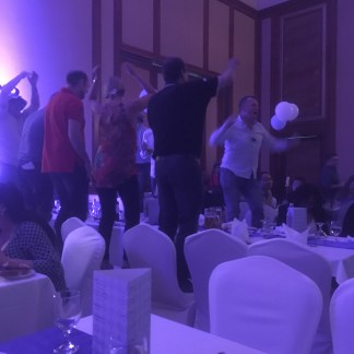 Dancing on the tables. Not my group, sadly.