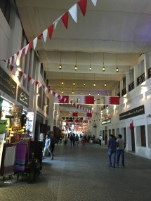 Finishing up last minute Christmas shopping at the Souk. It was decorated for Bahrain National Day (December 15th).