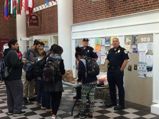 Bedford Police Chief Robert Bongiorno, an MCC alum, joined Officer Craig Naylor for the college's first Coffee with a Cop on Main Street in Bedford