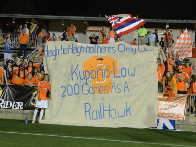 Carolina fans present Kupono Low with a banner celebrating his 200th game for the team (Photo: Carolina Railhawks)
