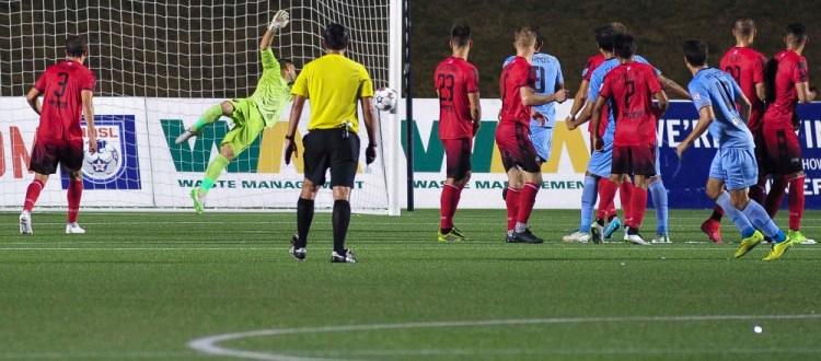 Romuald Peiser stretches toward the shot from Daniel Mendes' last second free kick. (Photo: Steve Kingsman/Ottawa Fury FC)