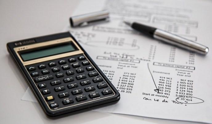 calculator-and-pen-on-document.jpg
