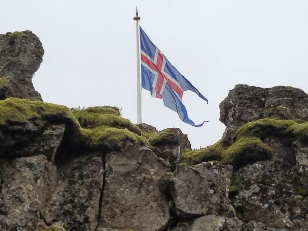 Iceland's flag flying over Thingvellir National Park on the Golden Circle Route Tour