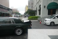 Rolls Royce leaving Peninsula Hotel with an overloaded boot