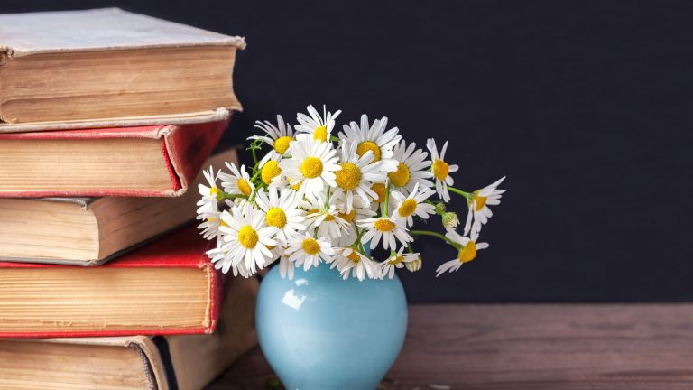 Book stack and vase of flowers