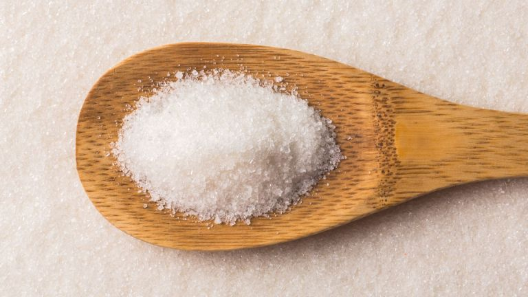 wooden spoon filled with sugar