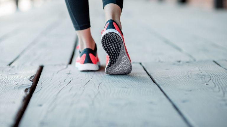 a runner's feet from behind