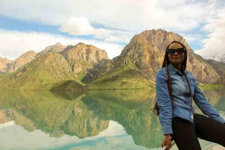 Boat ride in Iskanderkul Lake overlooking nearby mountains