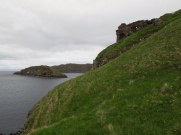 Castle ruins clinging to the edge of the island